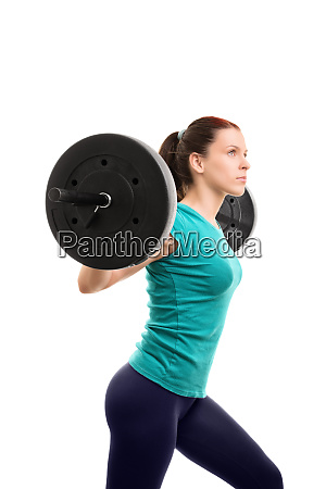young girl lifting weights