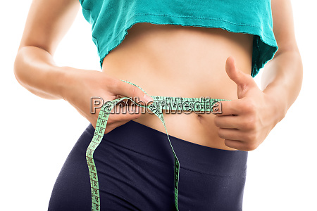 young girl measuring her waist