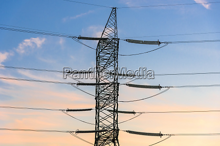 closeup of electricity pylon and lines