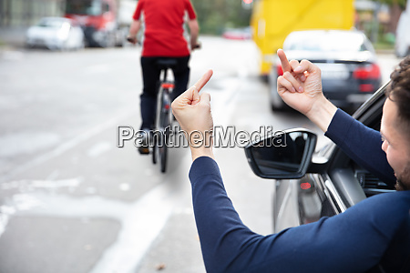 angry driver showing middle finger to