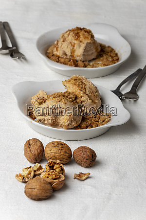 two portions of walnut ice cream