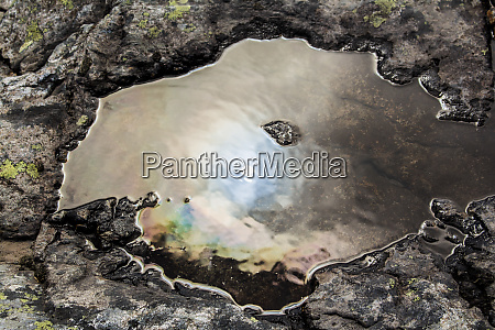 oily water hole in the water