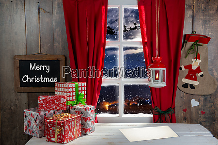 christmas gifs decoration near rustic window