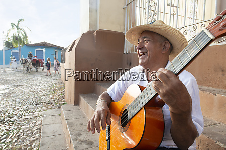local man singing and playing his