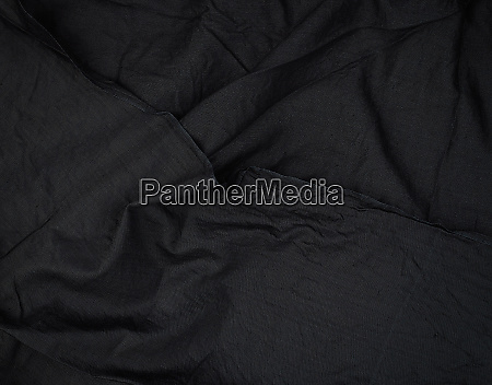 fragment of black cotton fabric with
