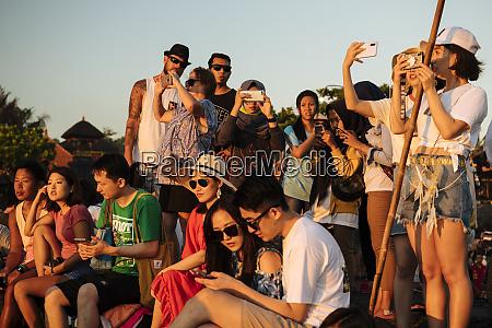 tourists, enjoying, sunset, at, tanah, lot - 27388584