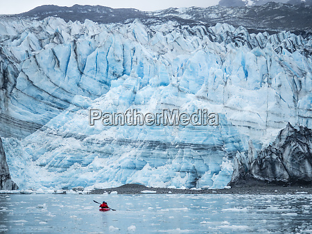 a kayaker paddling in front of