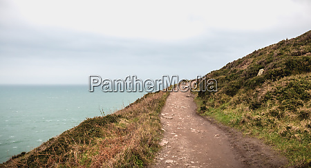 hiking trail on cliff skirting the
