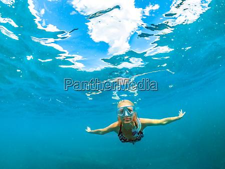 female in bikini swimming underwater seychelles