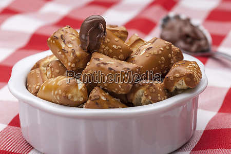 pretzels and chocolate frosting