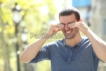 adult man scratching itchy eyes in