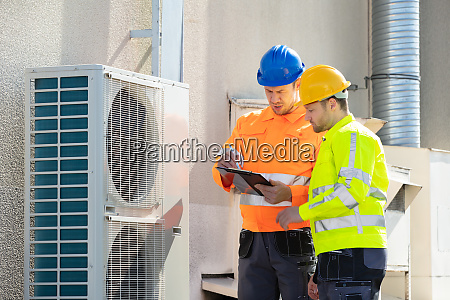 an electrician men checking air conditioning