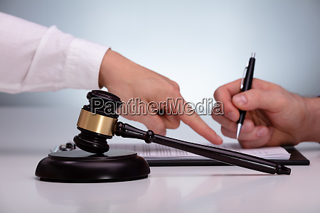 gavel in front of lawyer advising