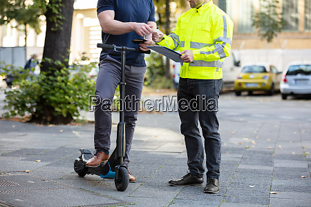 man on electric scooter showing drivers