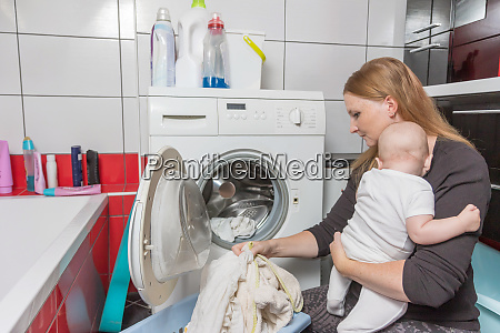 laundry at home during motherhood concept