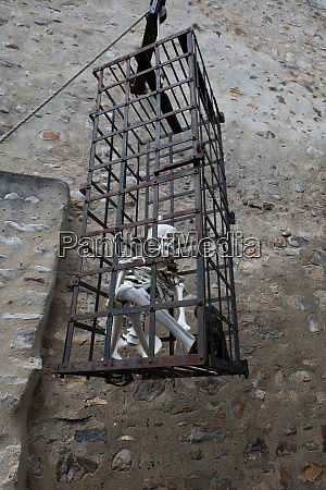 skeletion in a cage