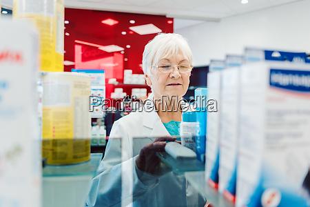 saleslady in drug store sorting thru