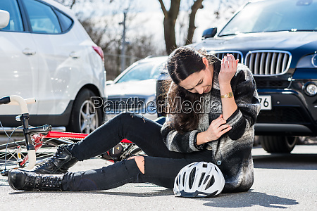 injured woman sitting on the ground