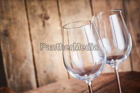 two elegant wineglasses with remnants of