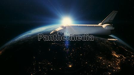 space shuttle in orbit above planet