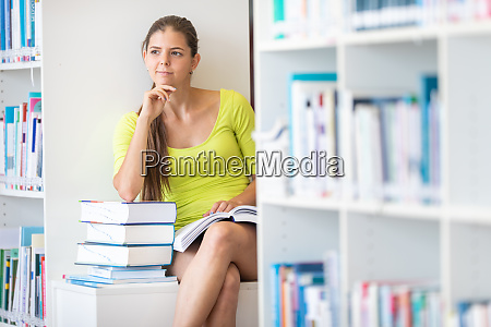 cute female universityhighschool student with books