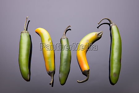 five jalapeno ppers laid out