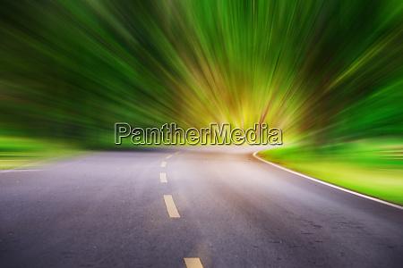 blurred asphalt road blurred blue sky