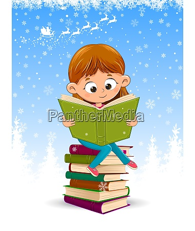 baby girl reading a book at