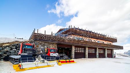 snow groomers mountain hut livigno italy