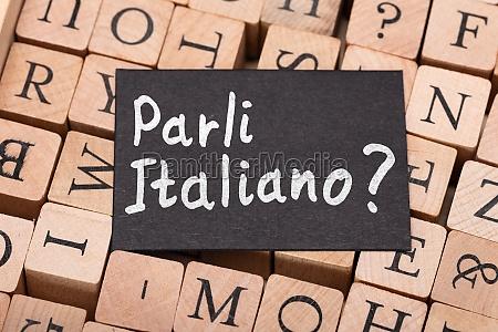 speak italian question on letter wooden