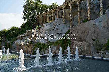 aqueduct and fountain on the slope