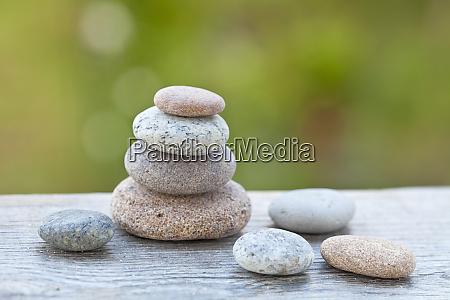 well balanced pebble stack across green