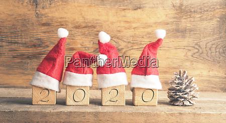 hats of santa with wooden blocks