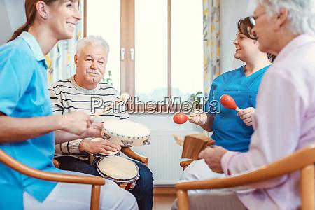 seniors in nursing home making music