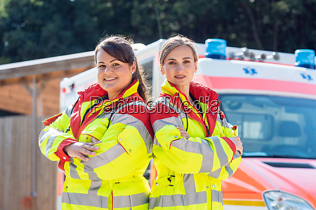 paramedic and emergency doctor in front