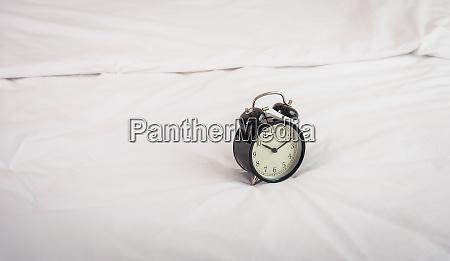 black alarm clock at 8 am