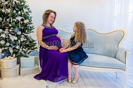 beautiful pregnant woman in ultra violet