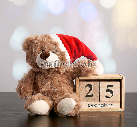 brown teddy bear in red hat