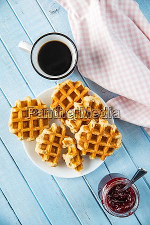 tasty sweet waffles with raspberry jam