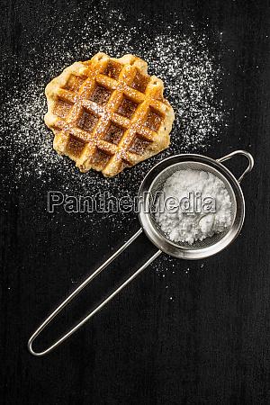 belgian waffles sprinkled with sugar