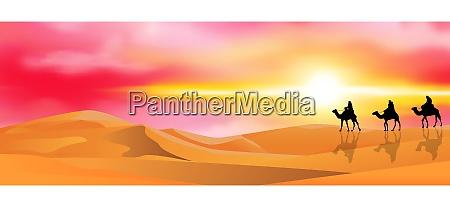 camel caravan in the desert at