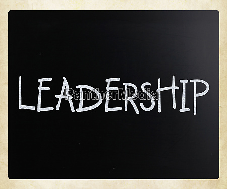 the word leadership handwritten with white