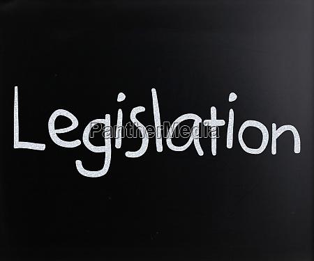 the word legislation handwritten with white