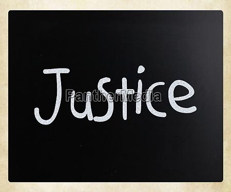 justice handwritten with white chalk on
