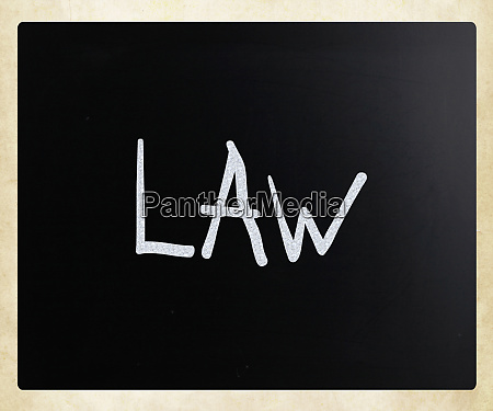 the word law handwritten with white