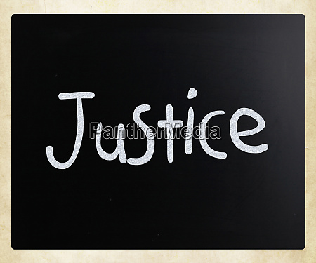 the word justice handwritten with white