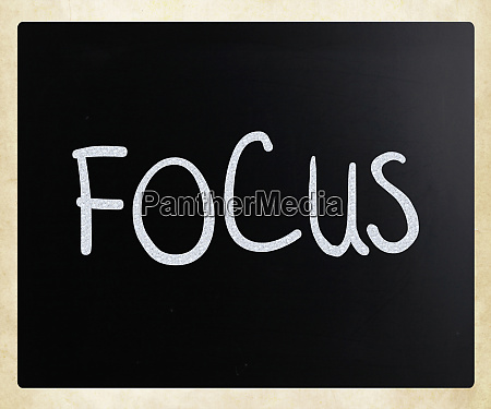 the word focus handwritten with white