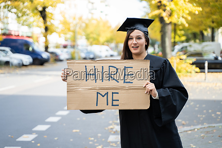 graduate student standing with hire me