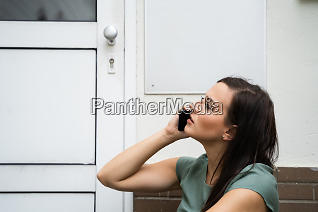 young woman waiting in front of