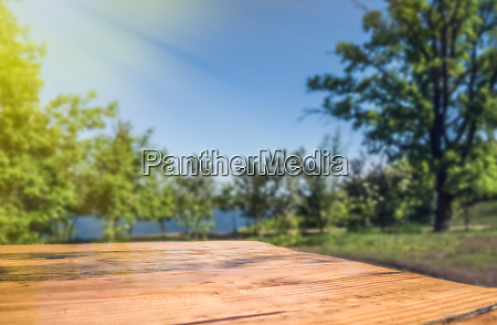 empty wooden deck table with park
